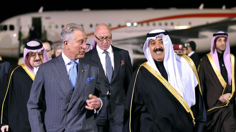 Saudi National Guard Minister Mutaib bin Abdullah bin Abdulaziz walks with Britain's Prince Charles in Riyadh airport